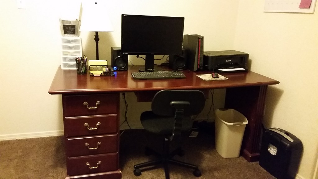 Office Desk and Black Rolling Chair