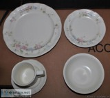 piece plate setting never use, place in China Cabinet for vie
