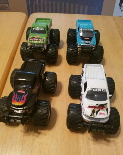 lot of 4 monster truck maisto tonka 1999 fords and dodge mud truck