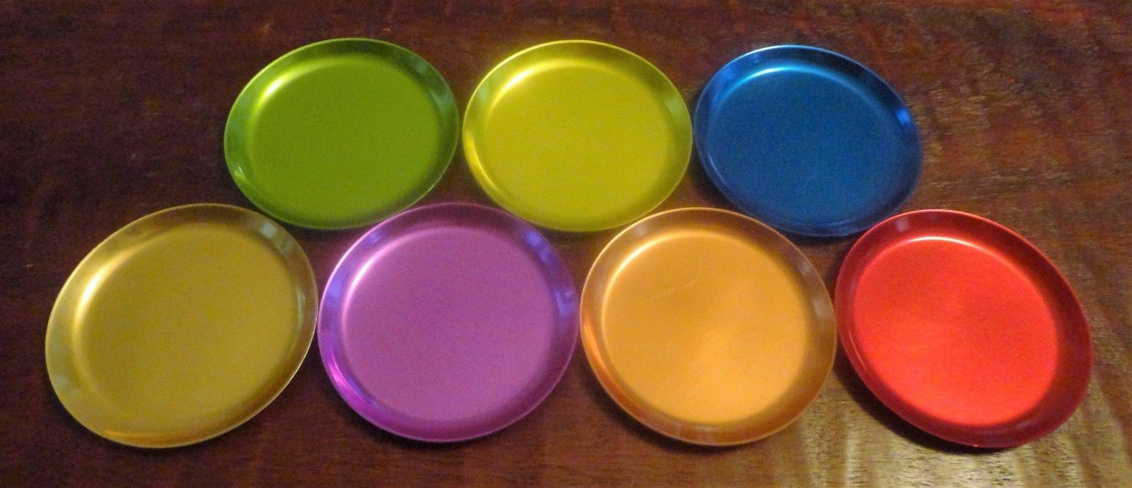 Set of SEVEN (7) - West Bend Color Glo (?) Aluminum Coasters - 3 5/8