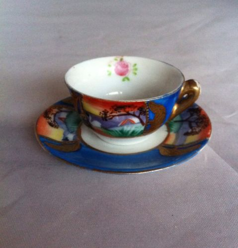 Miniature Japan Hand Painted Teacup And Saucer