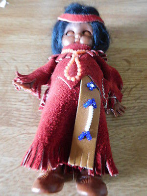 Souvenir Indian doll with leather clothes