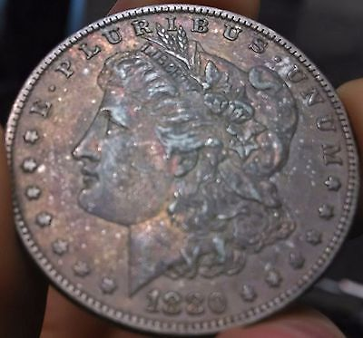 1880-O Toned Morgan Silver Dollar