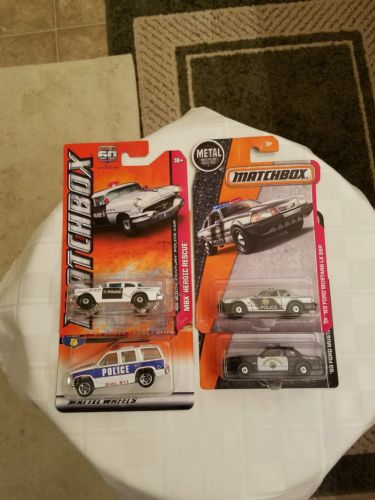 MATCHBOX LOT OF 4 POLICE CARS DIECAST.