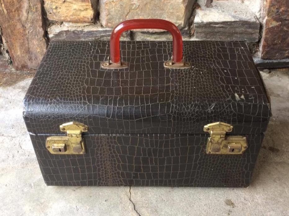 Vintage train travel case with bakelite handle