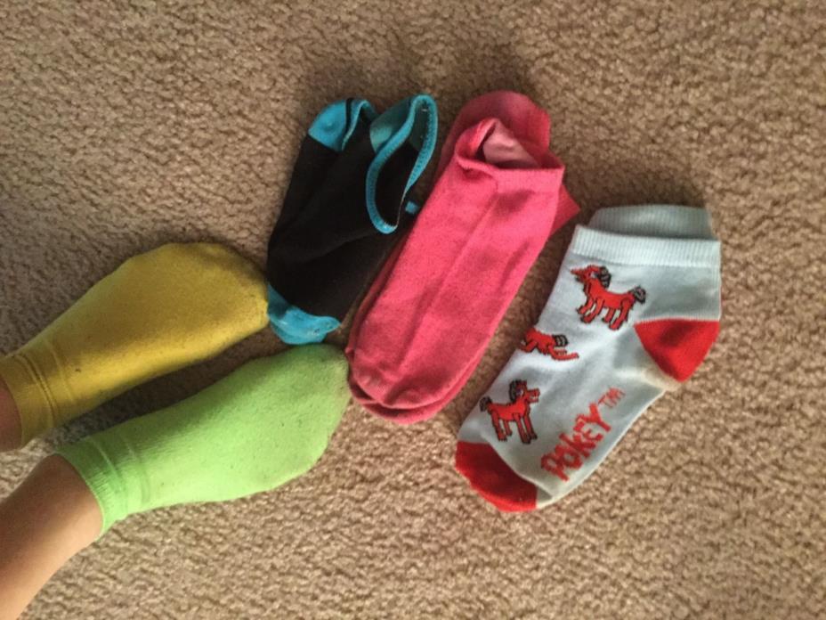 single pair of well worn womens used socks