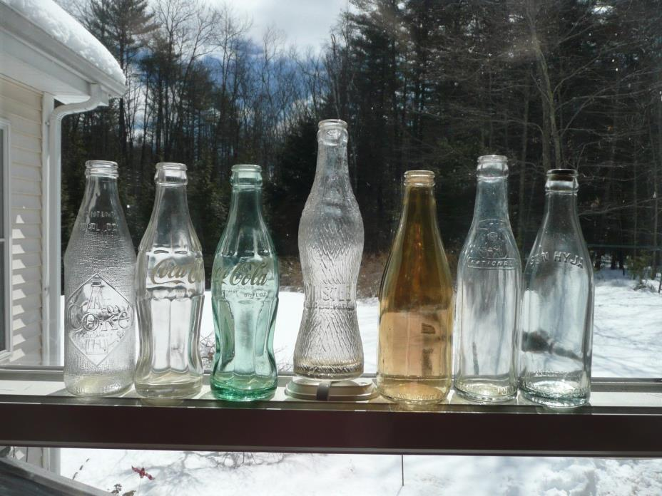 A LOT OF  SEVEN VINTAGE SODA BOTTLES CIRCA EARLY 1900'S