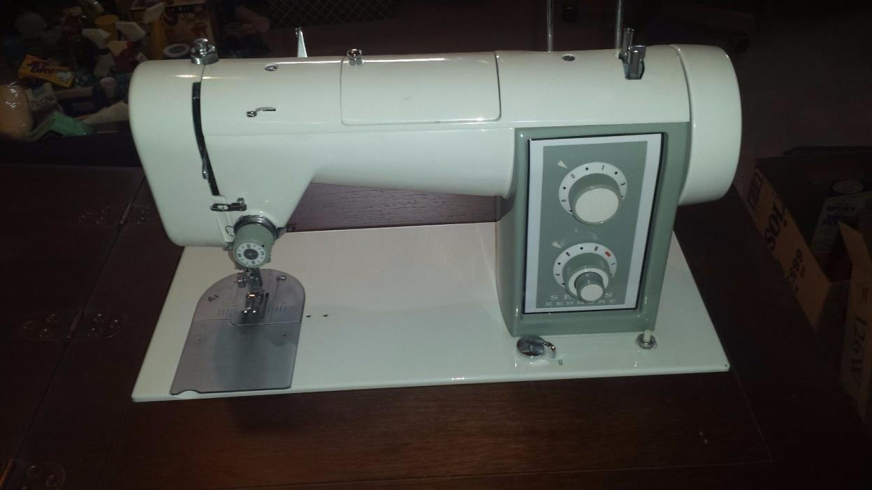 Kenmore sewing machine and cabinet for sale classifieds for Decor 99 sewing machine