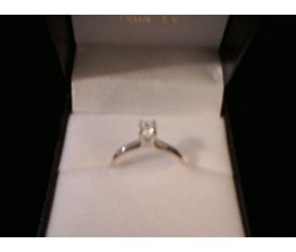 size 7, quarter carat diamond engagement ring, 14kt gold. 4 prong setting