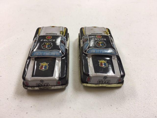 Vintage Tin Toy Police Car Pair