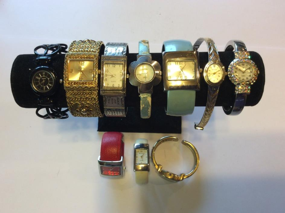 Large lot womens bracelet watches,intact,need batteries for parts/repair    T261