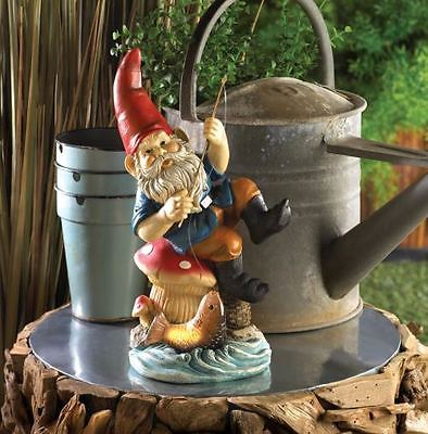 HAPPY LITTLE FISHING GNOME SOLAR STATUE HOOKED A FISH THAT GLOWS AT NIGHT