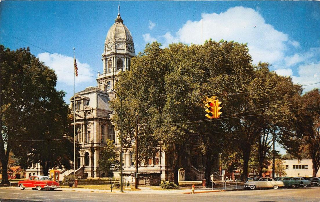 WARSAW INDIANA  COURT HOUSE~NICE OLD CAR~PHONE BOOTH~TOWER CLOCK POSTCARD c1950s
