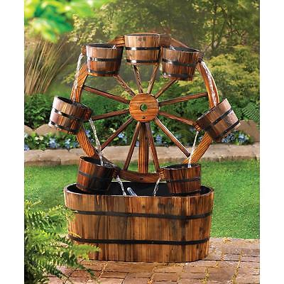 Old-Fashioned Wooden Wagon Wheel Water Fountain
