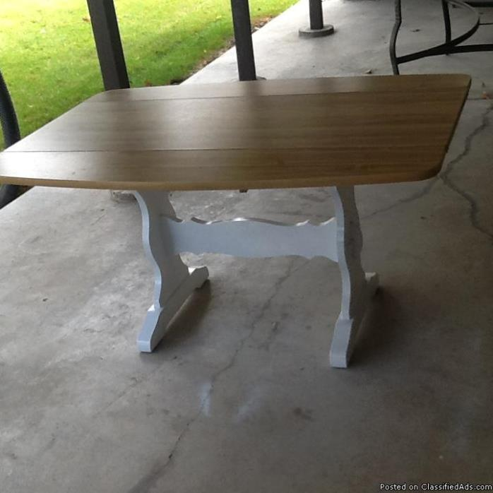 Kitchen table. Small house or apartment size. 2 fold down leaves