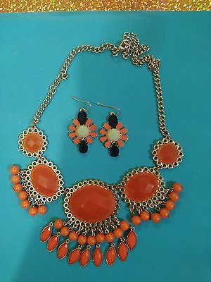 Orange and Gold beaded necklace and orange, black and liime green pierced earrin