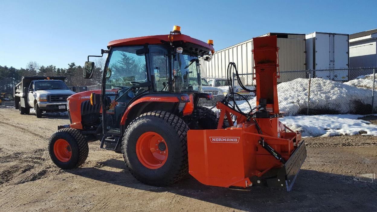 Kubota L6060 tractor with Normand 82