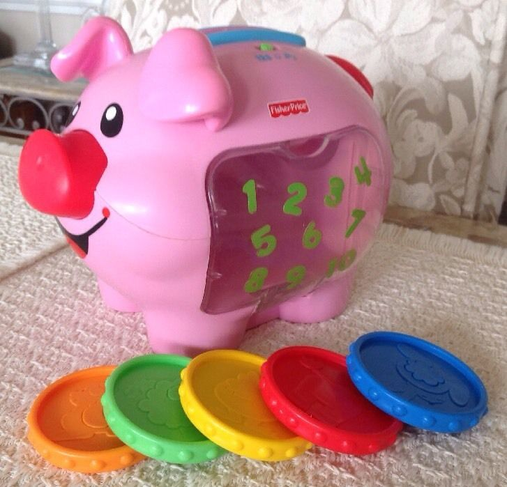 Fisher Price Laugh and Learn: Learning Piggy Bank - Comes with 5 Coins, J2462