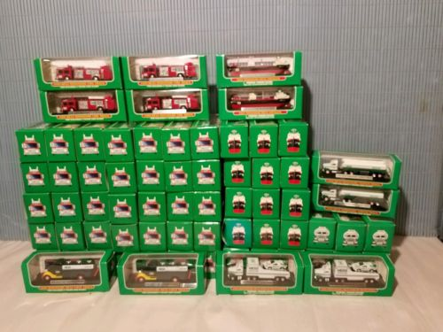 HESS MINIATURE TRUCKS LOT OF 68 IN NEW CONDITION