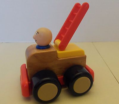 Vintage Playskool Fire Truck - Moving Ladder, Turning Wheels, and Fireman
