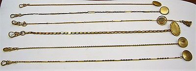 MIXED GROUP SIX ANTIQUE GOLD FILLED AND GOLD PLATED MARKED POCKET WATCH CHAINS