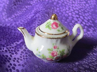 miniature china teapot with hand painted flowers