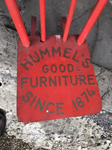 A Small Vintage Red Wooden Rocking Chair With Advertising Hummel's Furniture