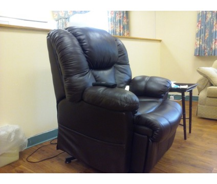 Brown leather electric recliner chair - like new