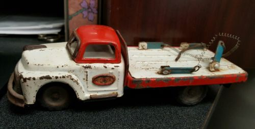 Vintage Friction Lumber Truck Toy