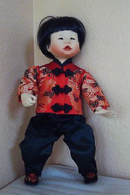 Edwin M Knowles Porcelain Asian Doll
