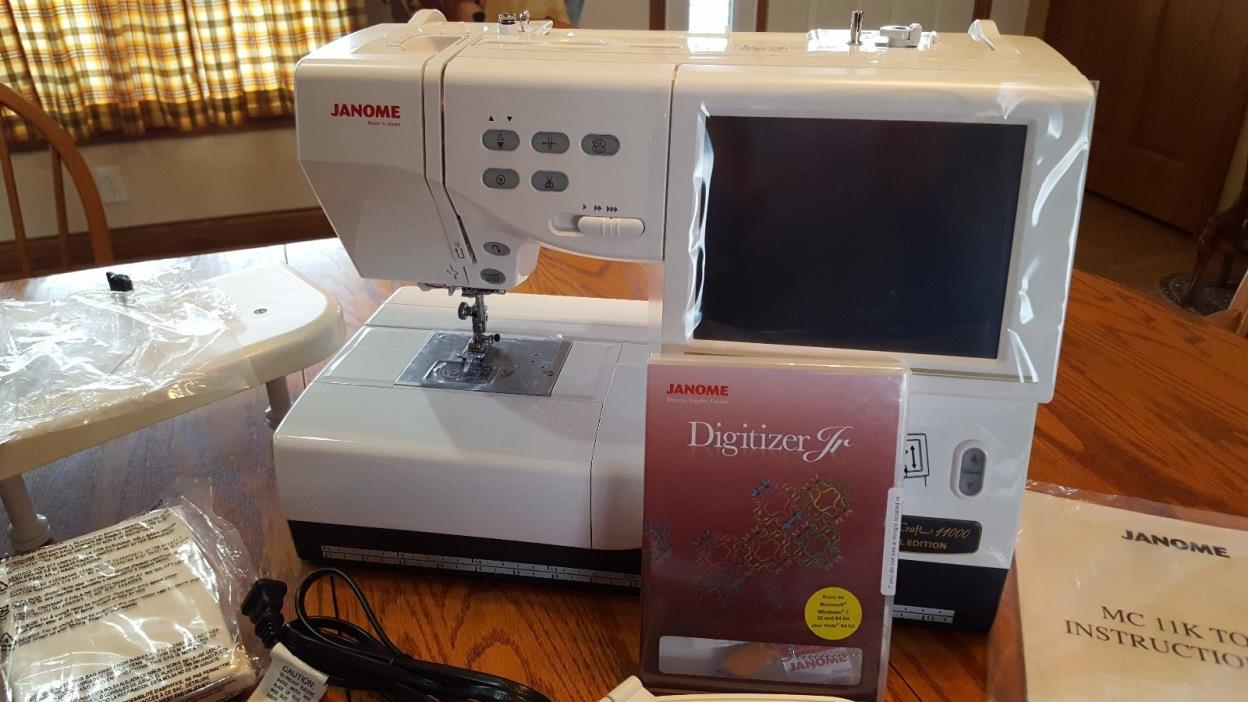 Janome Memory Craft 11000SE Embroidery/sewing Machine with extras