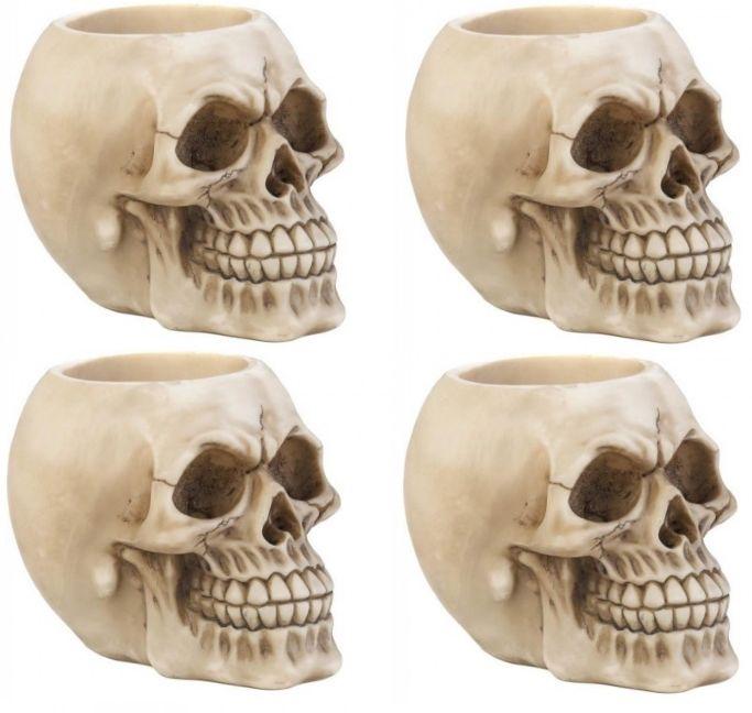 FOUR SKULL PEN HOLDERS