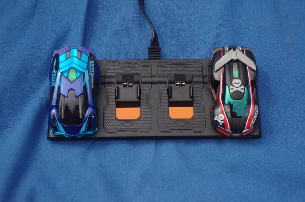 2 ANKI OVERDRIVE SLOT CARS (GROUND SHOCK & SKULL) PLUS CHARGER!!
