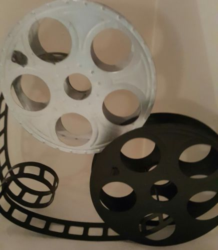 movie film reel to reel wall hanging decor black and silver sold as is worn mark