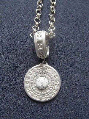 Vintage signed Liz Claiborne pendant with chain.