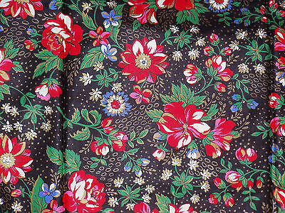 Cotton fabric large floral print gold accent Christmas colors print on black
