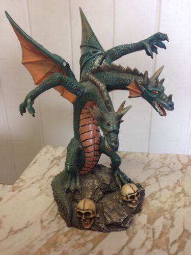 Two Headed Dragon Statue with Two Skulls