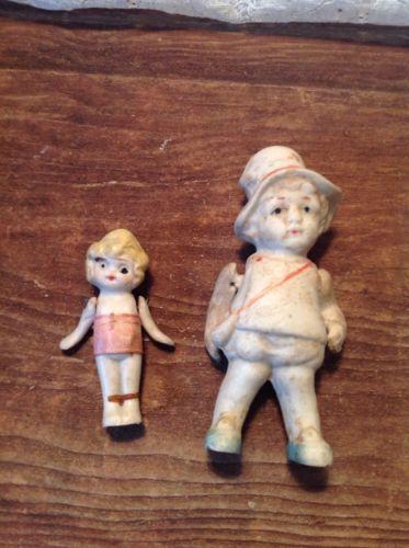 Pair Of Antique Bisque Porcelain Dolls