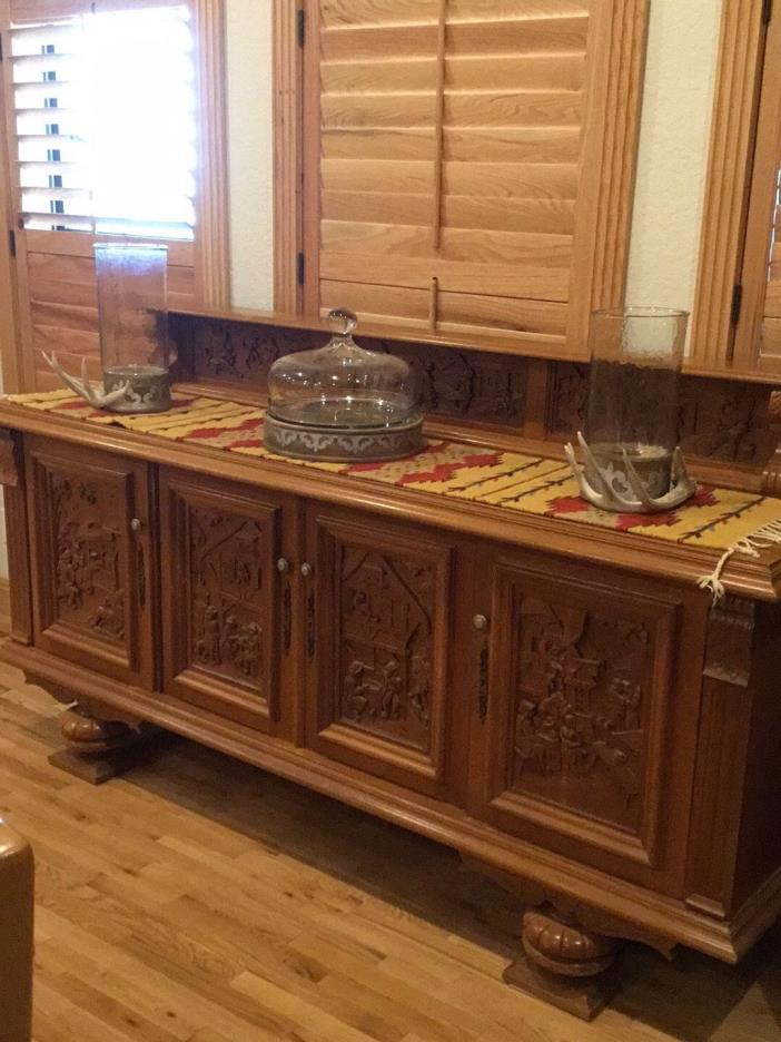Beautiful buffet  with cabinetry.