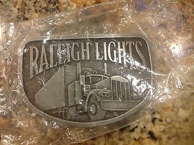 NEW Raleigh Lights - Belt Buckle - Metal - Vintage Semi Truck