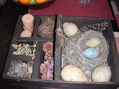 primitive wood carrier with easter decor