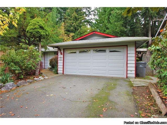 Groovy opportunity for some great sweat equity in this 70's custom home!