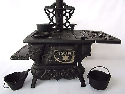 Vtg CAST IRON CRESCENT TOY STOVE Miniature Wood Stove ~ Including pots and pans