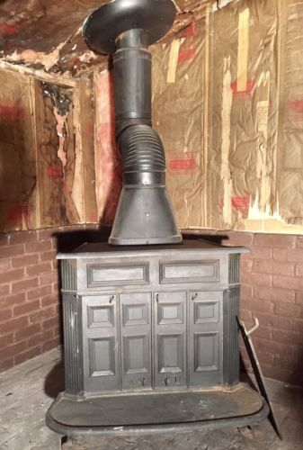ANTIQUE FRANKLIN WOOD STOVE