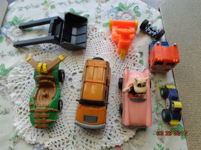 A LOT OF EIGHT  (8) SMALL MISC TOY VEHICLES AND PARTS