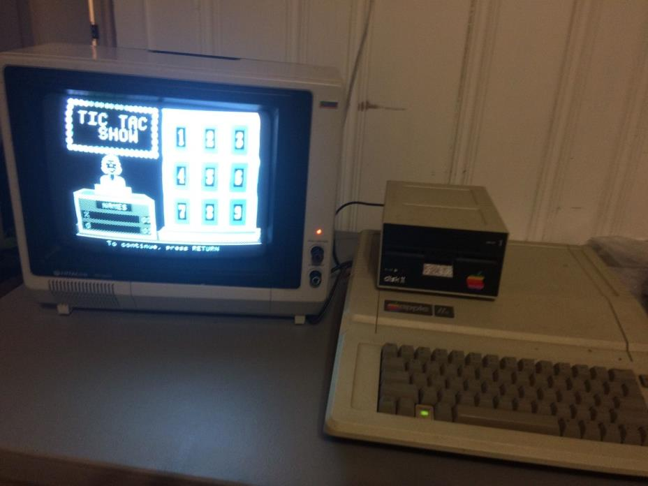 Apple IIe working with monitor DiskII drive apple into disk and stickers working