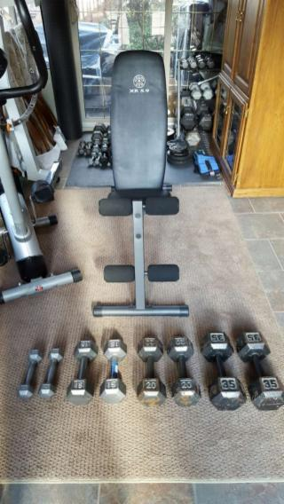 Weight bench and hex dumbbell set.