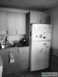 IKEA kitchen cabinets counters sink fridge microwave