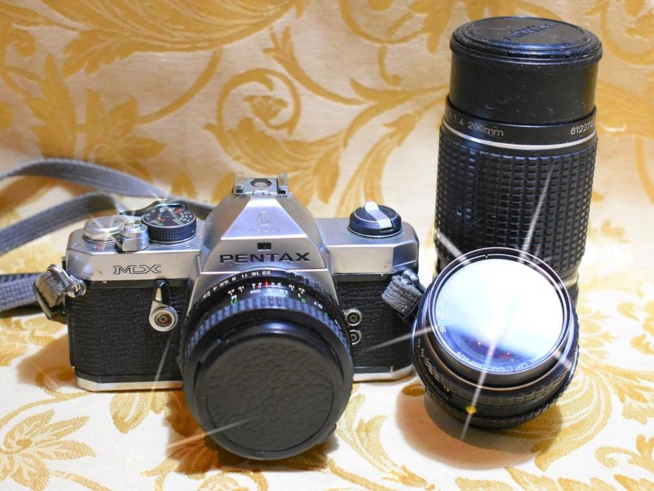 Pentax MX with three lens (200mm-28mm and 55mm)