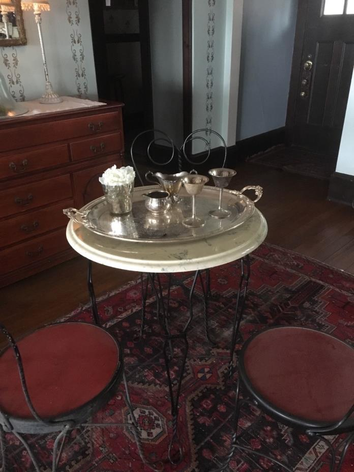 Ice cream parlor set. Marble top. In great shape. 3 chairs.